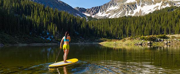 woman riding paddle board